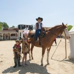 Western theme park kids and a horse